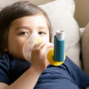 young child using inhaler